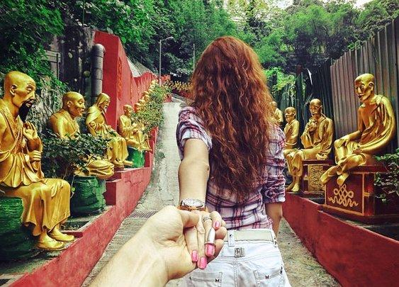 Girlfriend Leads Man Around the World (Photos)