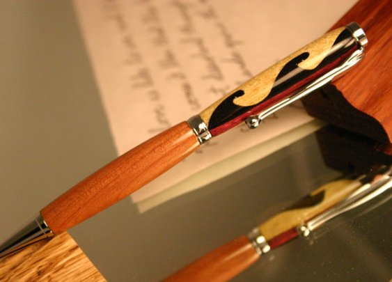 Wood Pen with intricate hand carved Maori wave by HopeAndGracePens