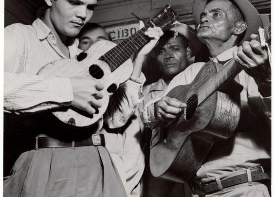 The puertorican cuatro accompanied  by a guitar