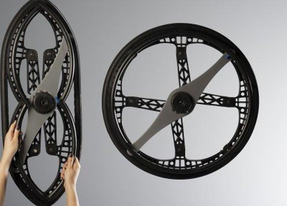 The Morph Wheel folds in half to make wheelchair travel easier
