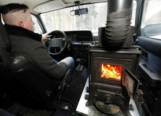 Zany Swiss man installs wood-burning stove in car