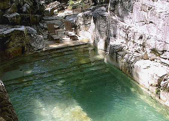 Backyard pool built into the existing limestone quarry