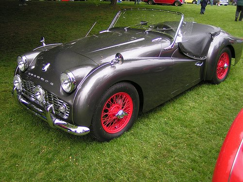 Triumph TR3 In Silver With Classy Red Wheels