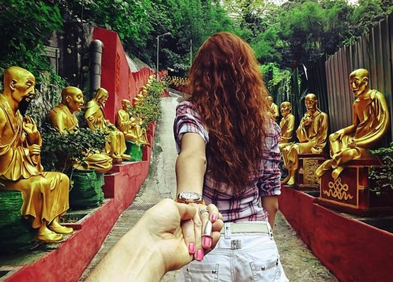 Photographer's Girlfriend Leads Him Around the World -