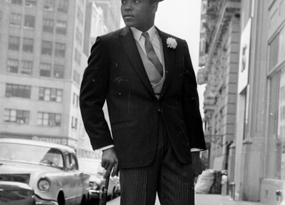 Muhammad Ali with Hat, Umbrella, and Spats
