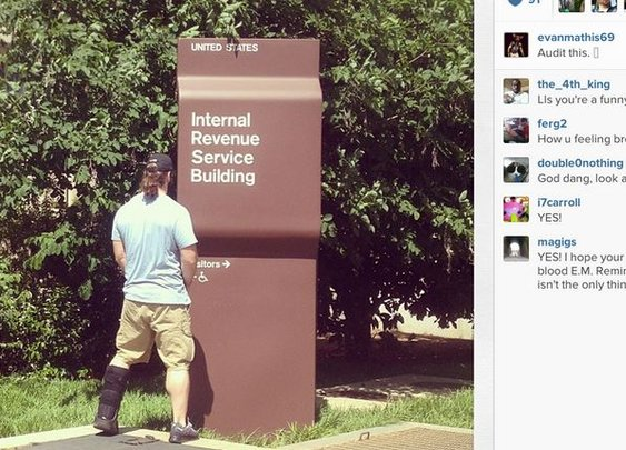 Photo: Eagles Evan Mathis Peeing on IRS Building Sign  | Robert Littal Presents BlackSportsOnline