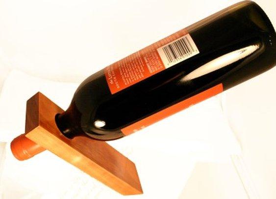 Minimalist cherry wood wine rack balance wine bott by Hope & Grace Pens