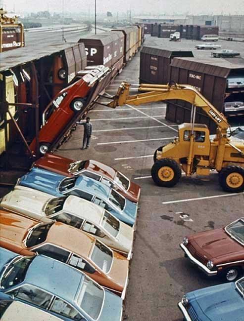 Loading Chevrolets onto a train