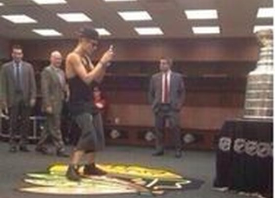 Idiot Justin Bieber poses with Stanley Cup And Hockey Fans Outraged