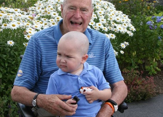 George H.W. Bush shaves head in solidarity with 2-year-old leukemia patient
