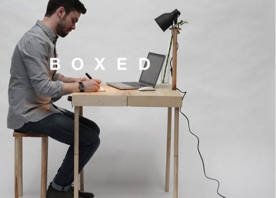 Boxed kit packs office furniture into a portable briefcase