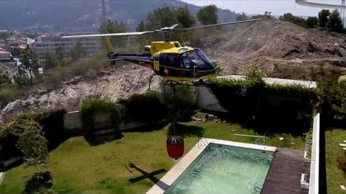 Watch A Fire-Fighting Helicopter Steal Water From A Pool