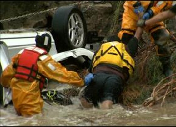 Rescue Crews Save Man From Car In Creek