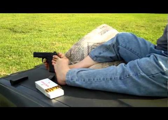 Michael shoots his  45 with his feet - YouTube