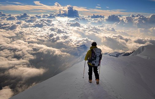 Standing above the clouds in the Alps