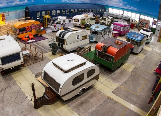 indoor campground hostel hosts vintage RVs as rooms