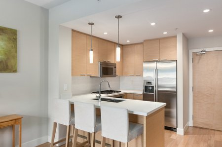 A superb Kits location, w/high end quartz kitchen counters, premium Bosch stainless steel appliances