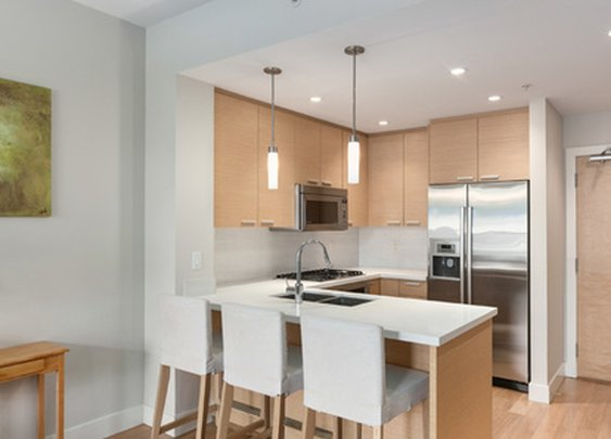 A superb Kits location, w/high end quartz kitchen counters, premium Bosch stainless steel appliances