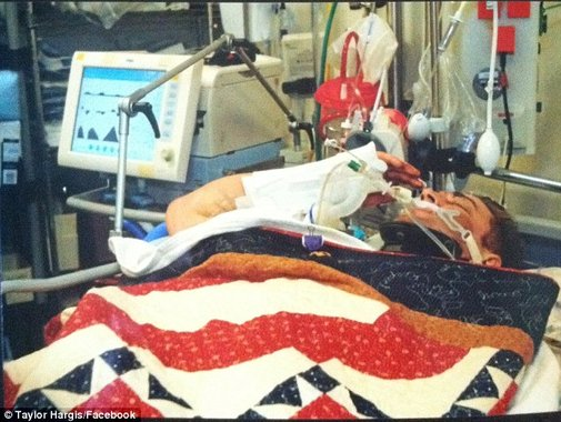 Mettle of honor: Seriously wounded soldier defies doctors and searing pain to salute commanding officer ,