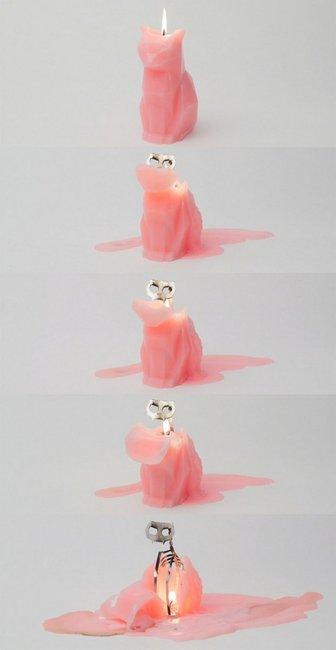 Tis The Season: Cat Candle Melts To Reveal Skeleton | Geekologie