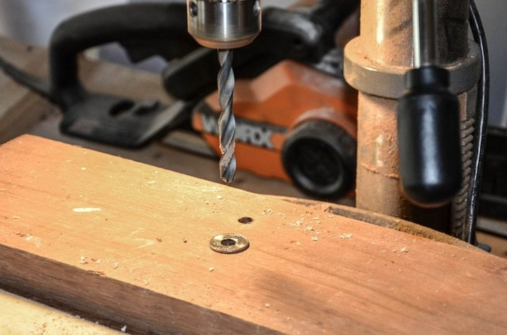 Designer Drills Holes into Quarters, Turns Them into Rings
