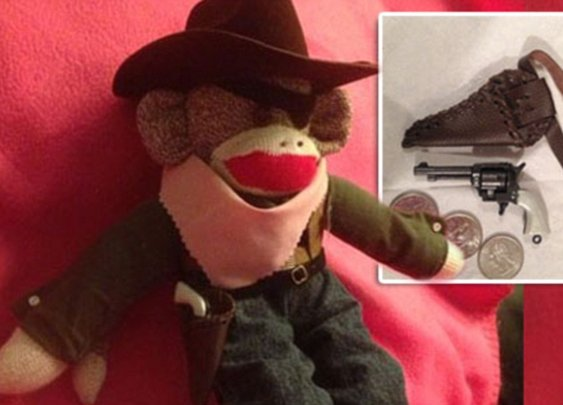 TSA confiscates two-inch toy gun from woman's Sock Monkey
