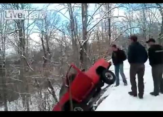Can one truck pull another off a snowy precipice? - YouTube