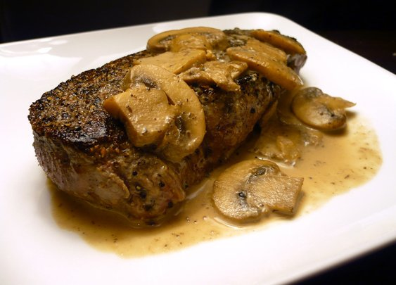 Pepper-crusted steak with mushrooms