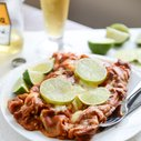 Spicy Beer Braised Lime Chicken Enchiladas | How Sweet It Is