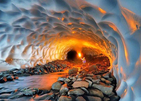An Illuminaed Snow Tunnel in Russia