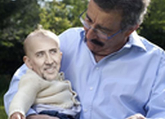 People Holding Baby Nic Cage