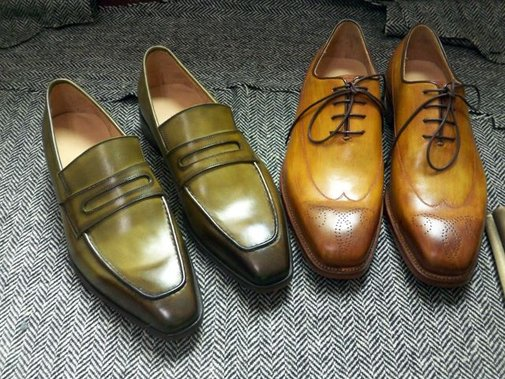 The first color is applied by hand to the leather and left to be absorbed.