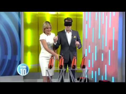 Turn it around! Sarah Harris almost shoots herself with a nail gun - YouTube