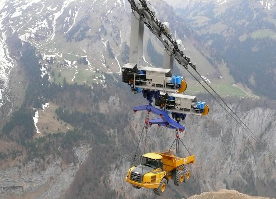 Truck transported on a ropeway going up a 5,400-foot mountain
