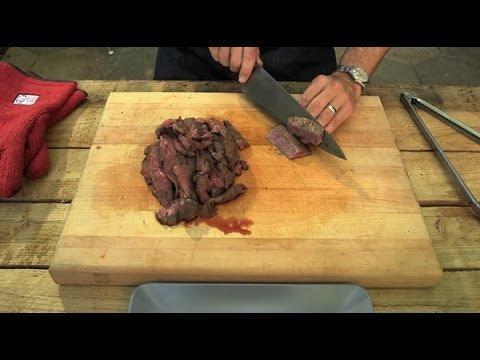 Alton Brown Cooks Caveman-Style: Steak On Coals