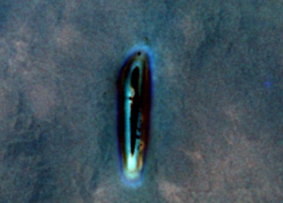 Bright Blue Metallic UFO Photographed By Astronaut