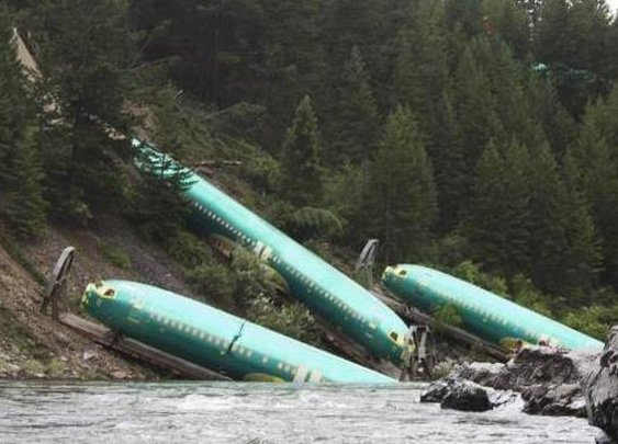 Train derails, ditches planes in water