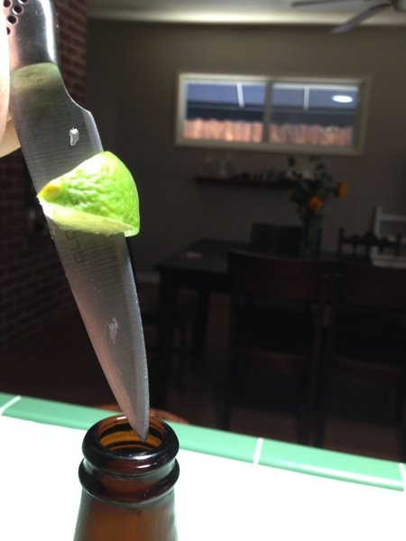 How to Properly  Add Lime to a Bottle of Beer
