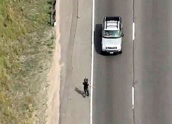 Dramatic footage of Colorado deputy drawing firearm while riding motorcycle