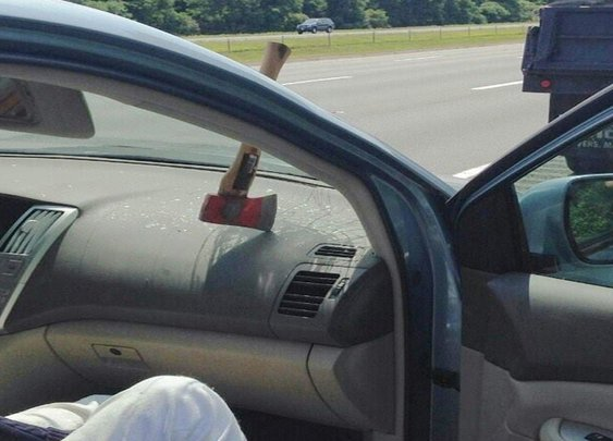 Axe Flies Through Windshield and Embeds Itself in Dashboard