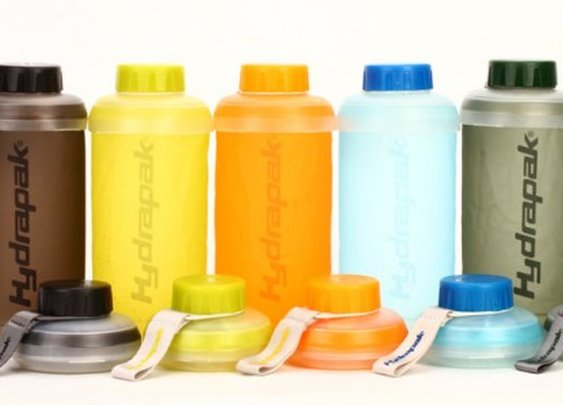 Hydrapak Stash collapsible water bottle stands up and packs into a pocket disc
