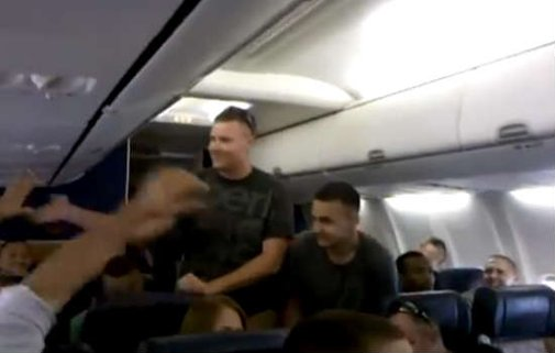 VIDEO: Marine Wows Passengers with a Beautiful Rendition of 'Home'