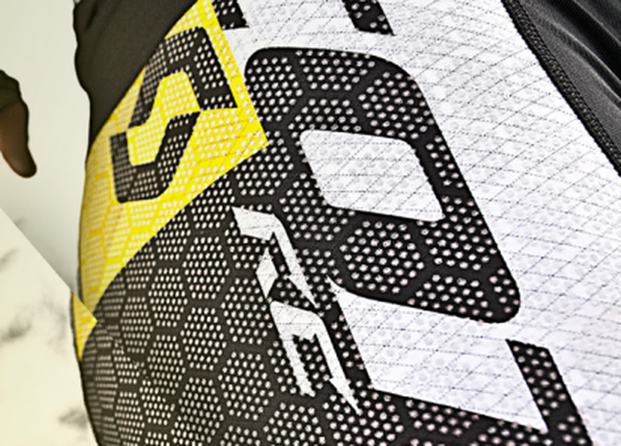 Ceramic-studded carbon fiber fabric made to protect cyclists from road rash