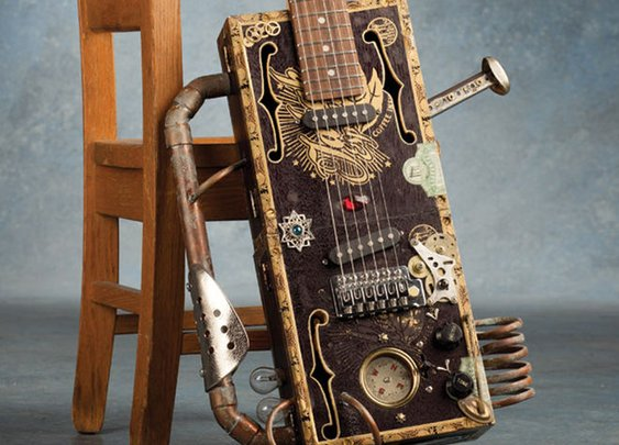 Spectacular Moments of Wonder with Dr. Monocle | A gallery of cigar box guitars. (via Cigar box...