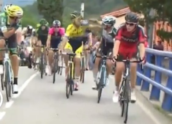 Two Cyclists In A Race Start Punching Each Other, While Going Uphill, For 200 Meters