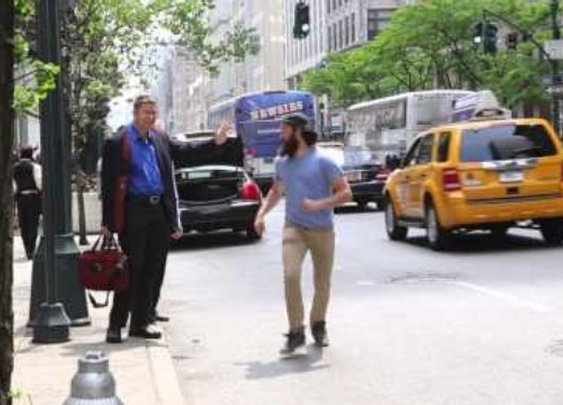 Bearded Man Runs Around NYC High-Fiving People Hailing Cabs