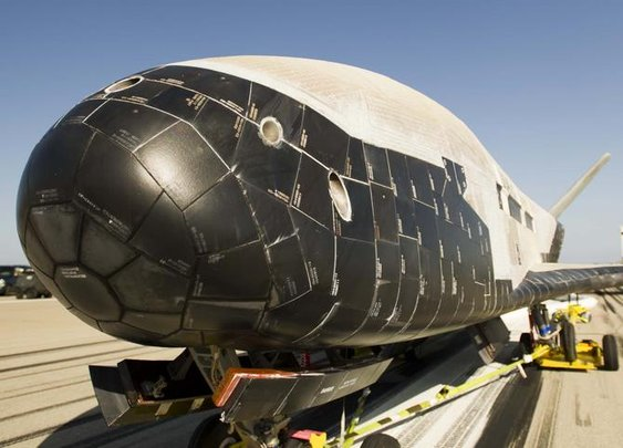 Secretive X-37B space plane returns to Earth, two years on - CNET