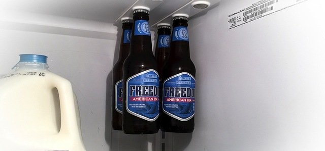 World's First Magnetic Bottle Hanger Is The Futuristic Space-Saver For Your Fridge