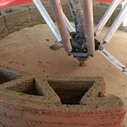 Wasp's 3D printers produce low-cost houses made from mud