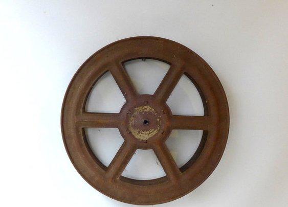 Vintage industrial rusty cinema movie film reel spool by evaelena